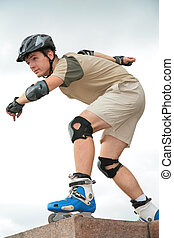 Boy on rollerblades in starting position