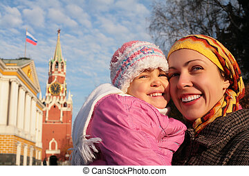 mother with little girl in Kremlin faces