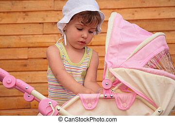 Girl with children\'s carriage