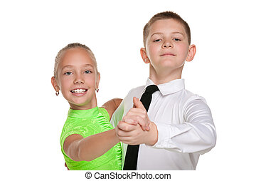 Two happy dancing children - A handsome boy and a pretty...