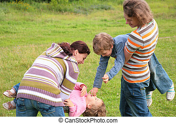 Family with two children plays outdoor