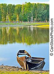 Traditional boat in the danube river in spring time
