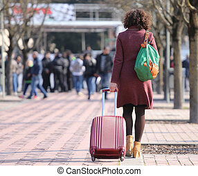 business woman travelling with the trolley