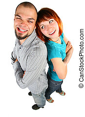 Young man and woman stand back to a back and grimaced