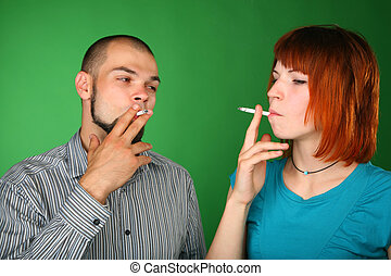 Smoking man and woman on green background