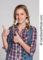 Pretty teen girl with her thumbs up