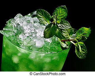 Green cocktail on dark background. - Green drink with mint...