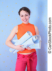 young  woman with rolls of wall-paper