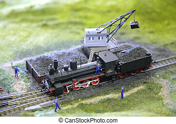 Model of steam locomotive is loaded by coal