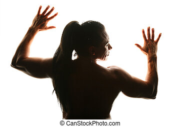Silhouette of woman bodybuilder from back with fingers
