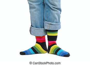 Two feet in multi-coloured socks