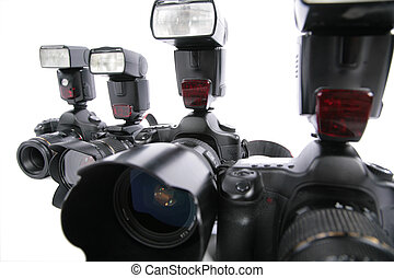 Close-up four �ameras with flashes on white background