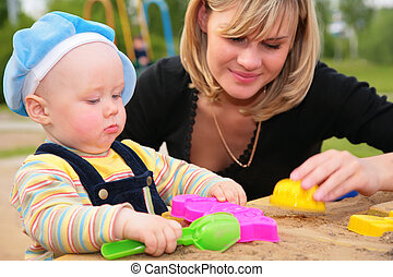 mother and child in sandbox