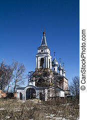Repair of the old temple on background blue sky