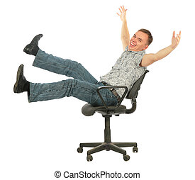 Young casual man laugh sits on chair
