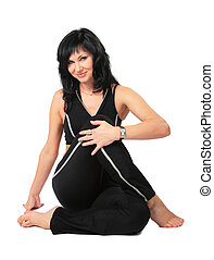 Sport brunette in black  makes exercise