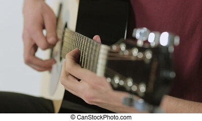 Close-up of a guitarist playing in the studio - Close-up of...