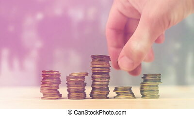 Hand stacking coins as money savings, managing home budget...