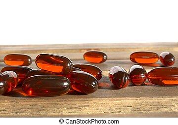 dietary supplement pills on wooden desk
