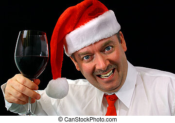 Christmas Party - Man wearing Santas hat drinking a glass of...