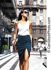 Young beautiful woman walking away - Young beautiful...