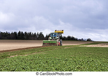 tractor on the acre - tractor plowing the acre