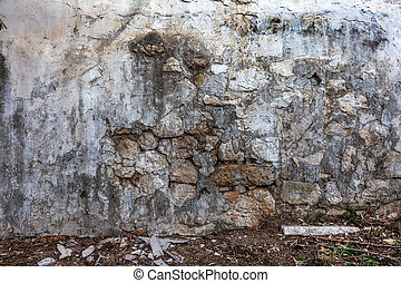 Beautiful old wall with large cracks and texture. Can be...