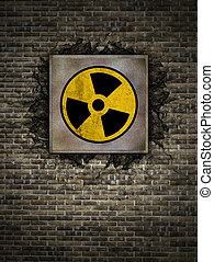 nuclear symbol - symbol of nuclear danger on an old wall