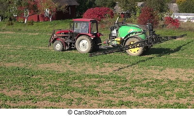 agriculture tractor spraying field - agriculture tractor...
