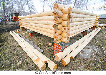 house under construction from pine logs - new house under...