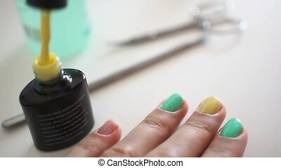 Manicurist doing spring manicure for woman in beauty salon....