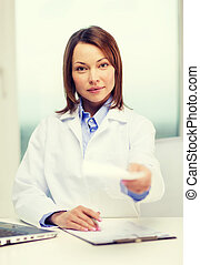 busy doctor with laptop computer and clipboard - medicine...