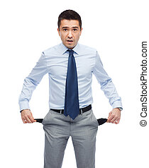 surprised businessman showing empty pockets - business,...