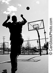 Basketball Shot - Silhouette of a basketball player shooting...
