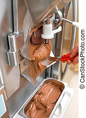 Producing ice cream - Producing chocolate ice cream with...