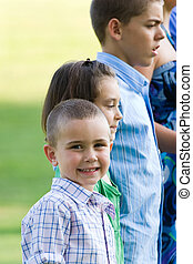 Kids In a Row - Young children standing in a row with a...