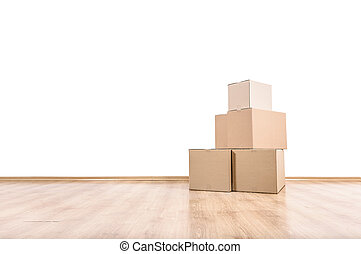 Moving boxes on the floor. - Empty room with a white wall...