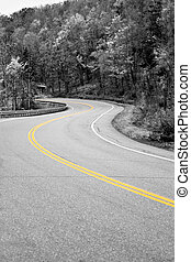 Yellow Line In the Road - A curved New England road with...