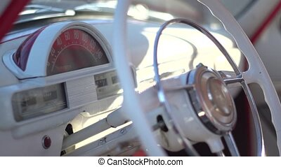 The dashboard and steering wheel of the boat