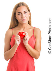 Woman Holding a Heart in Her Hands - Woman smiling and...