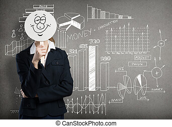 Business strategy - Businesswoman hiding her face behind...