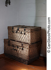 Ancient interior - Ancient baskets with things stand in a...