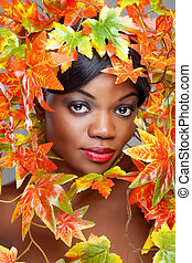 Beautiful young woman wrapped in leafs - Beautiful young...