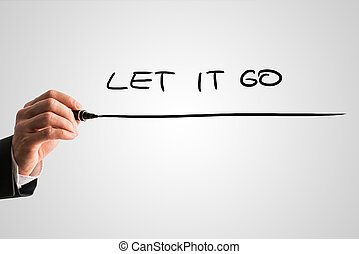 Let it go - Man writing the words - Let it go - with a black...
