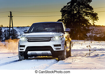 Powerful offroader car view on winter background - Powerful...