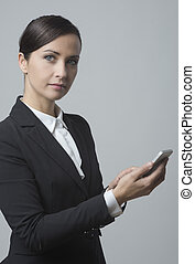 Businesswoman using mobile phone - Smiling confident...