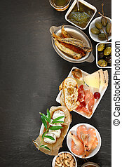 Assorted gourmet appetizers viewed from above with prawns,...