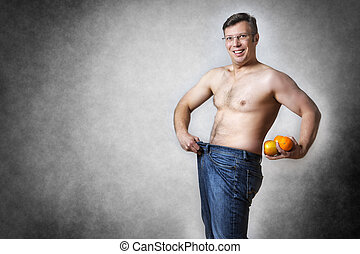 man with fruits has lost body weight - Image of a man in...