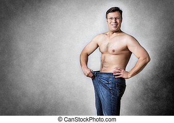 man has lost body weight - Image of a man in blue jeans who...