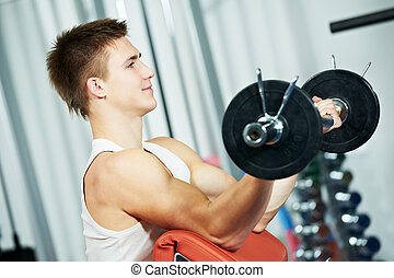 bodybuilder man workout biceps muscle exercises - athlete...